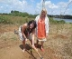 Anita Arneberg and Aina Søbakk planting a Mukau tree
