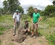 Jean-Paul Deprins and Jim Henning Olsen at one of the 50 mango trees Jim gave to the school (the plants are protected from goats)